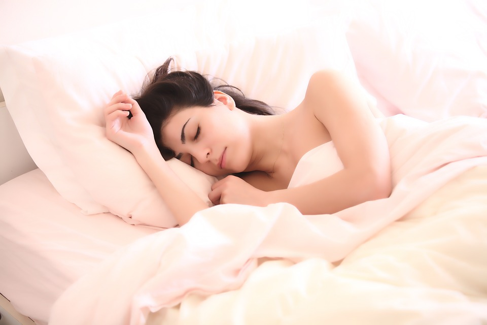 woman sleeping and relaxing on bed