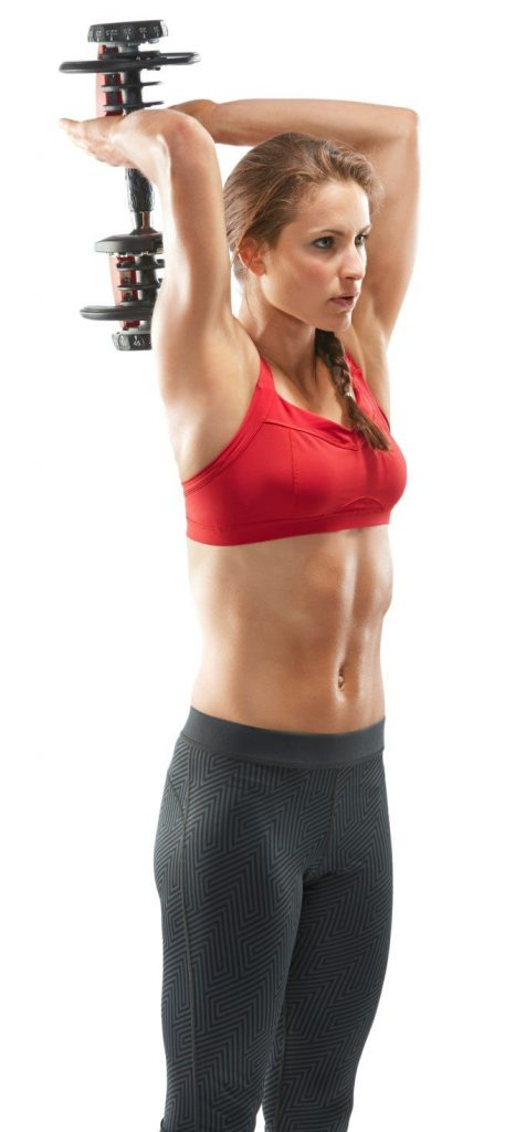 woman doing exercise with bowflex 552