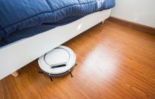robot vacuum working on wooden floors