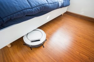 robot vacuum working on wooden floors