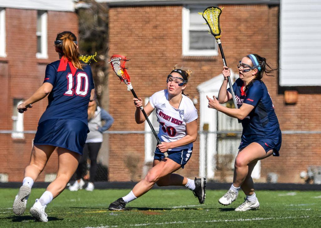 women lacrosse game in the field